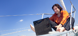 http://www.dreamstime.com/royalty-free-stock-photo-businessman-laptop-sailboat-image19559905